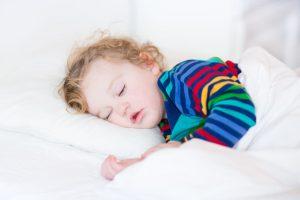 sleep children world Cute sleeping toddler girl in a white bed